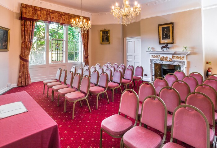 the Salisbury room set up theatre style with red velvet chairs facing the presenter's table