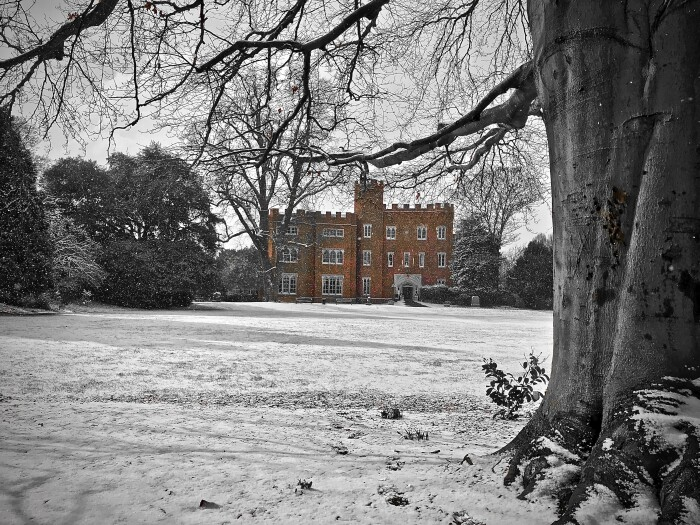 A shot of the castle from the back of the main lawn, it's red brick standing out against the white of the snow